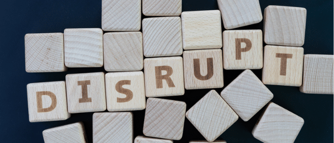 wooden letters spelling DISRUPT
